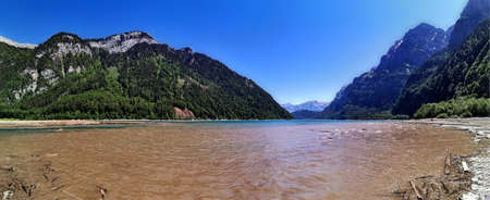 Swiss mountains and lake. Scenic Alps and lane view. Trekking and outdoor lifestyle