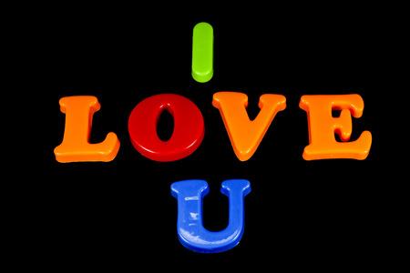 fondos negros: Amor colorido sobre fondo negro. Foto de archivo