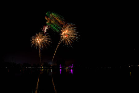 multiples: Fireworks of multiples colors on water