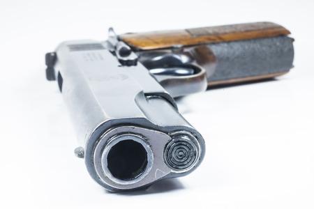 11 mm  Black handgun And ammunition isolated on white