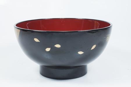 ceremonial: black bowl On white background Stock Photo