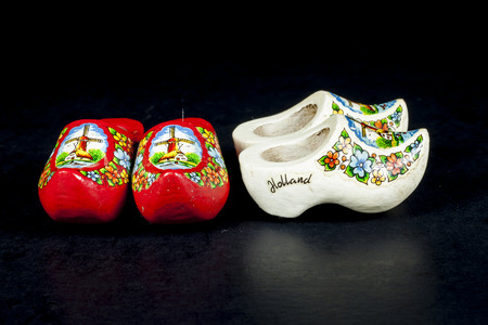 clog: wooden shoes from the netherlands isolated on black