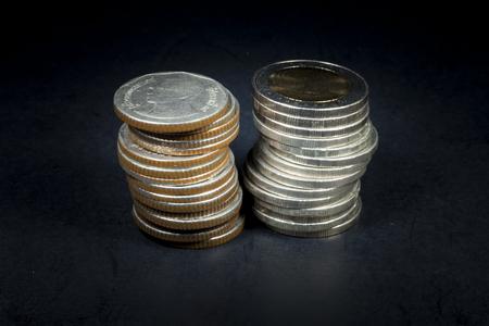 oz: coins  on black background Stock Photo