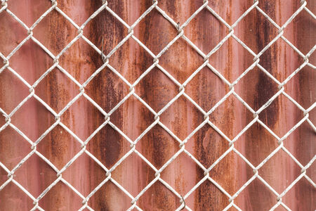 Wire Mesh and red corrugated fence  background photo