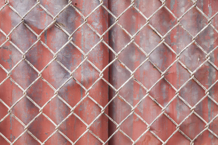 wire mesh: Wire Mesh and red corrugated fence  background Stock Photo