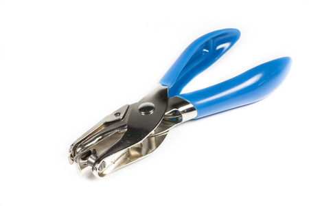 eyelet plier for punch paper on white background. photo