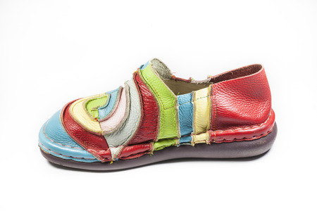 Bright multicolored leather shoes on a white background. photo