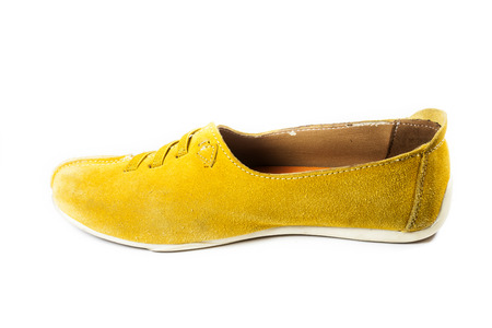 Bright yellow leather shoes on a white background. photo