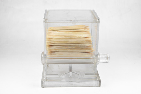 Box of toothpicks on a white background. photo