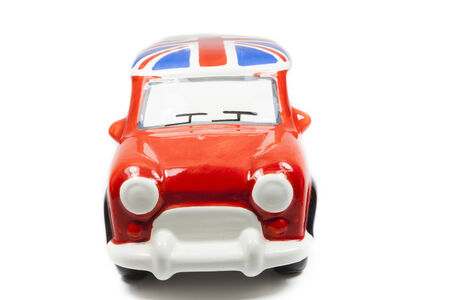 Red toy car on white background. photo