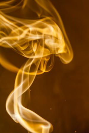 Gold smoke  on black background