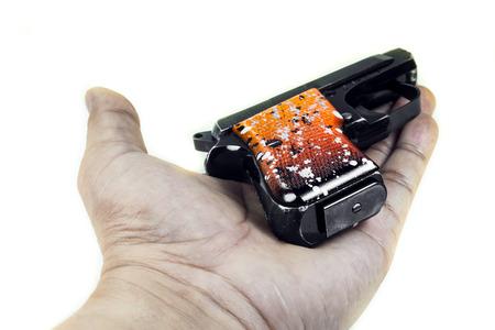 Small handgun 6.35 mm. on white background. photo