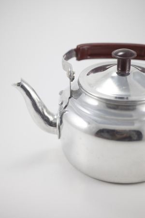 Old metal Kettle on a white background. photo