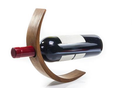 Wine bottle wooden  holder on white  Banco de Imagens