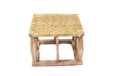 Small Wicker chair Thailand handmade on white . photo