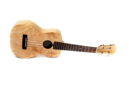 Ukulele hawaiian guitar on white .