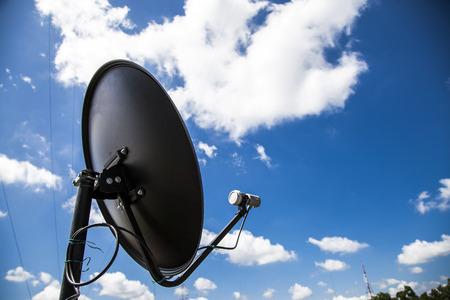 satellite dish on blue sky background.