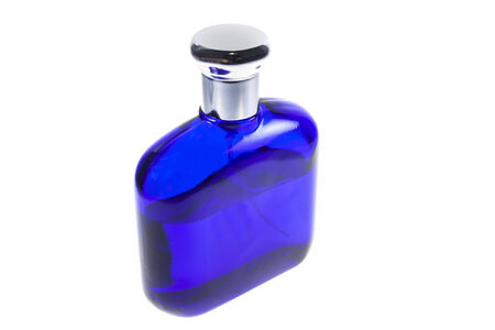 Blue bottle of perfume on a white background. photo
