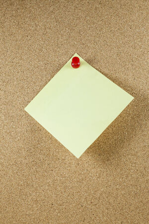 note paper background: Yellow note papers on cork board background.