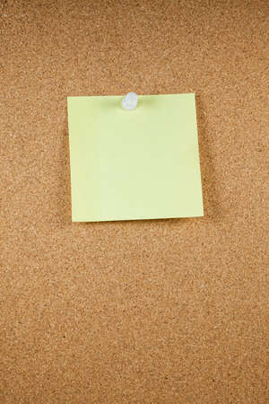 pinboard: Yellow note papers on cork board background.