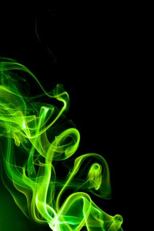 noxious: Green smoke on black background.