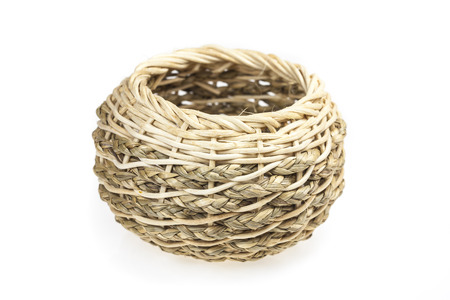 Small handmade wicker basket on white background photo