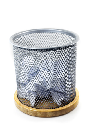 Waste papers and basket on a white background. 免版税图像