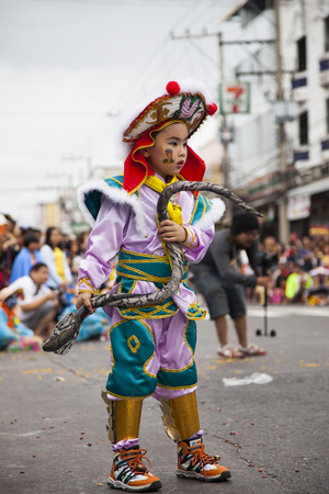 5 december: Udon Thani, Thailand -5 December 2014 Thailand  Fathers Day ,Chinese dragon during Udon Thani Shrine Annual Golden Dragon,Lion Parade, Udon Thani Shrine Year celebrations 2014