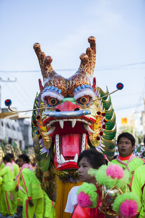 Udon Thani, Thailand -5 December 2014 Thailand  Fathers Day ,Chinese dragon during Udon Thani Shrine Annual Golden Dragon,Lion Parade, Udon Thani Shrine Year celebrations 2014