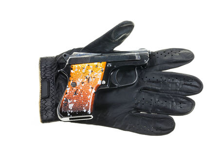 leather gloves: Gun on Leather gloves background.