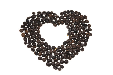 cofe: Heart lined with coffee beans. Stock Photo