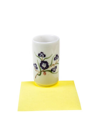 loamy: Antique tea cups ,Yellow stick note. Stock Photo
