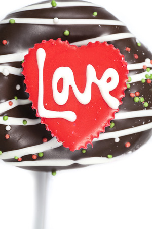 Chocolate of love in heart on white background. photo