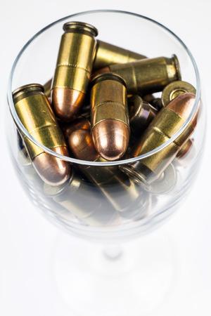 ammunition: Ammunition in a wine glass.