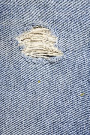 mezclilla: Azul rasgado textura pantalones de mezclilla.