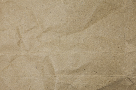 Old torn crumpled paper bag texture background.