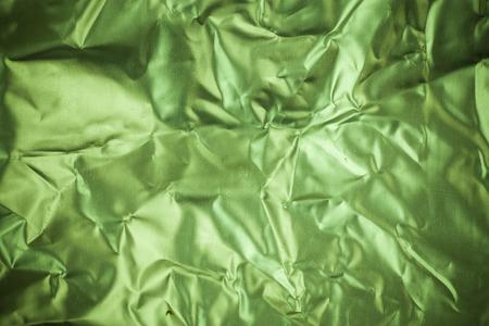 aluminum foil: Crumpled green aluminum foil background.