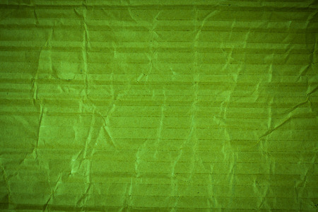 page background: Crumpled green cardboard texture. Stock Photo