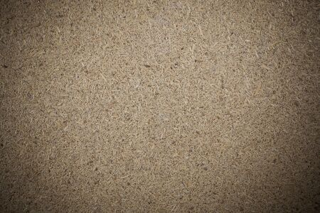 compressed: Texture recycled compressed wood chippings board background.