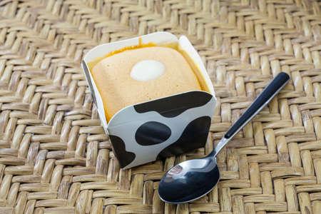 orange cake: Orange Cake on Cow Cup. Stock Photo
