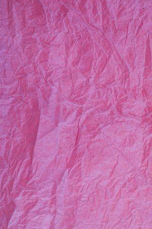 obsolete: Crumpled vintage red paper textured obsolete background.
