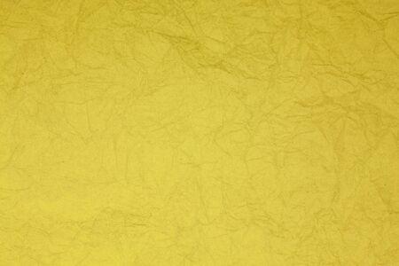 obsolete: Crumpled vintage yellow  paper textured obsolete background.