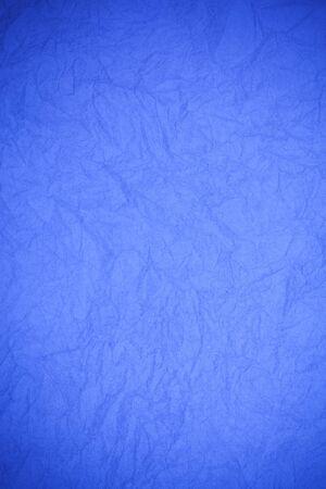 obsolete: Crumpled vintage blue paper textured obsolete background.