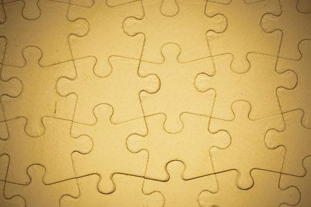 complete solution: Brown Jigsaw puzzle background.