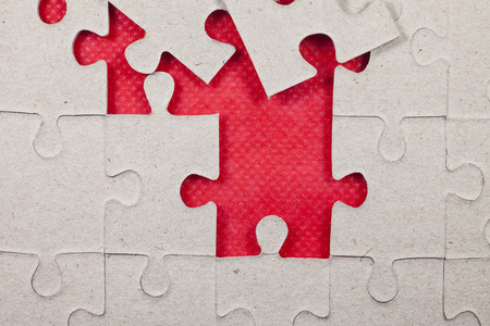 complete solution: Jigsaw on red background.