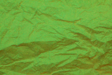 crumpled paper: Green crumpled paper background.