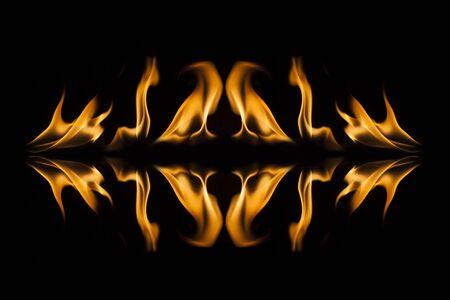 dynamic heat black: Fire flames on black background. Stock Photo