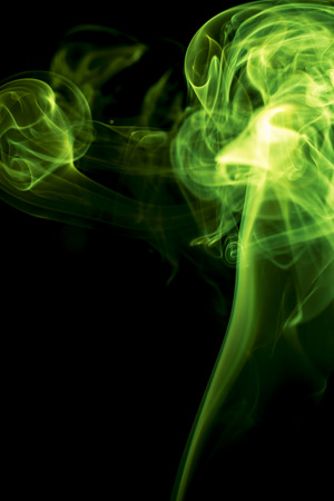 green smoke: Green smoke on black background.