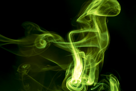 black smoke: Green smoke on black background.