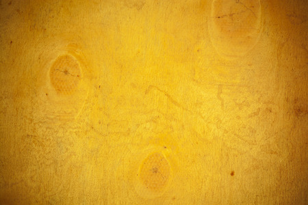 materia: Yellow wooden board background.